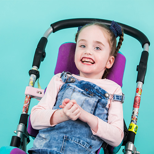 kayla smiling in push chair