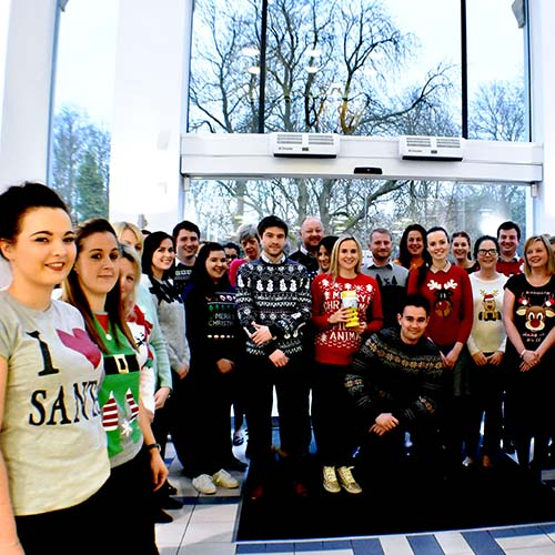 staff in xmas jumpers